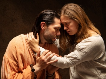 Matt Bowdren as John Proctor and Holly Griffith as Elizabeth Proctor. Photo by Tim Fuller, courtesy of the Rogue Theatre.