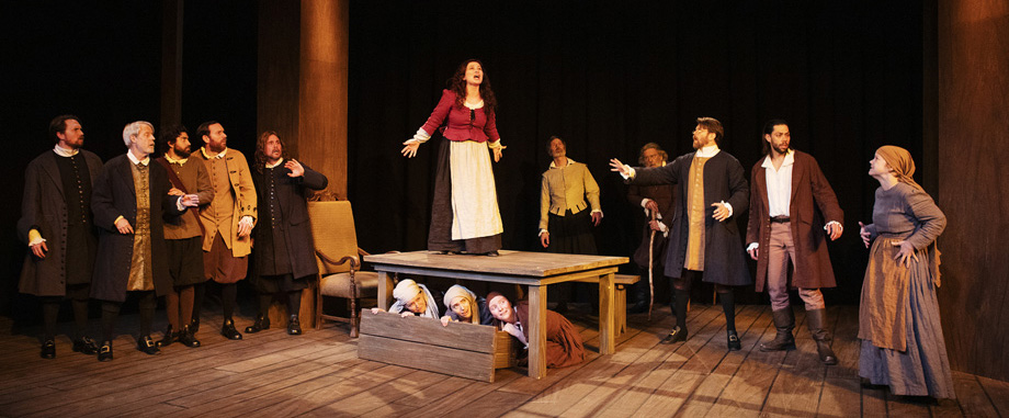 Bryn Booth as Abigail Williams and the cast of The Crucible. Photo by Tim Fuller, courtesy of the Rogue Theatre.