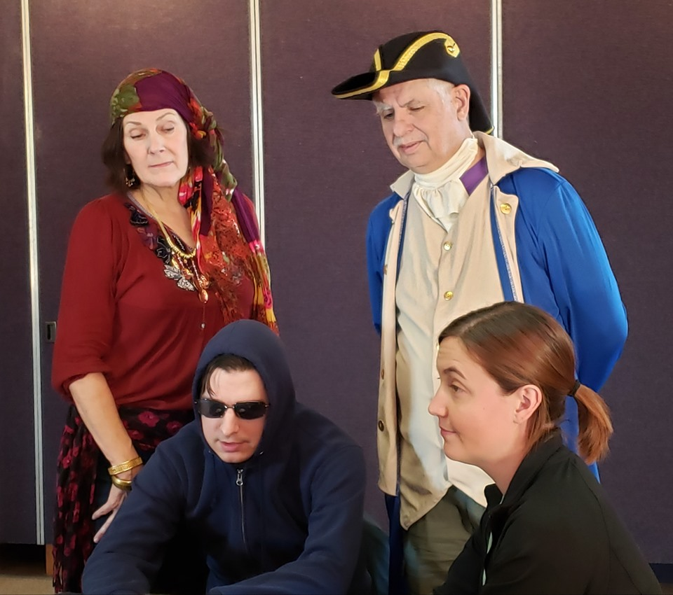 Joanne Mack Robertson as Claire Voyient, David Gunther as Nemo, Mike Manolakes as Professor Inanis, and Erin Hepler as Nulla. Photo courtesy of Serendipity Productions.